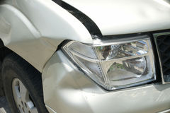 A dent on the right front of a pickup truck (damage from crash) Stock Photos