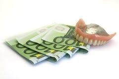 Dentaduras e dinheiro Imagens de Stock Royalty Free