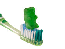 Dental 1. A picture of a gummi bear and a toothbrush, promoting teeth cleaning Stock Photo