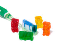 Dental 2. A picture of gummi bears and a toothbrush, to promote teeth cleaning Royalty Free Stock Photo