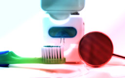 Dental. Photo of Floss, Toothbrush and Mirror With Color and Blur Effect Stock Photos