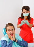 Dental anesthesia. Scared dental patient receiving anesthesia injection Stock Photography