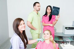 Dental assistance concept. With dentist team and happy patient royalty free stock photos