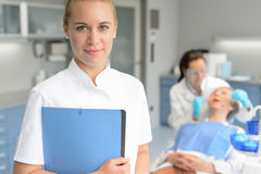 Dental assistant dentist checkup woman patient. Dental assistant dentist checkup women patient at stomatology clinic Royalty Free Stock Image