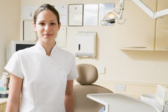 Dental assistant in exam room smiling. At camera Stock Photo