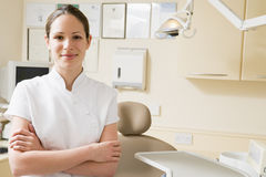 Dental assistant in exam room smiling Stock Images