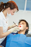 Dental assistant examining patient Royalty Free Stock Images