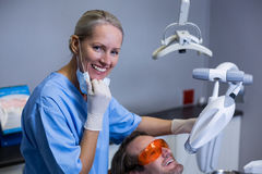 Dental assistant examining young patient mouth Stock Photography