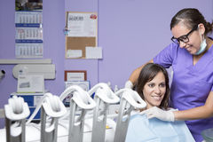 Dental assistant and female patient Stock Photos