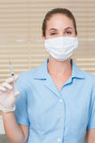 Dental assistant holding injection looking at camera Stock Photo