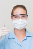 Dental assistant in mask holding dental explorer Royalty Free Stock Photos