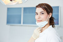 Dental assistant with mouthguard. Smiling dental assistant with mouthguard in dental practice Royalty Free Stock Photo