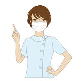 Dental assistant pointing up. A smiling female dental assistant with surgical mask waving her hand Royalty Free Stock Photography