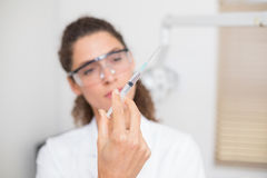 Dental assistant preparing an injection Royalty Free Stock Photography