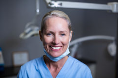 Dental assistant smiling in clinic. Portrait of dental assistant smiling in clinic Stock Images