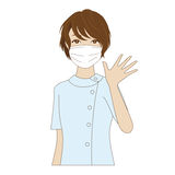 Dental assistant waving her hand. A smiling female dental assistant with surgical mask in uniform waving her hand Stock Image