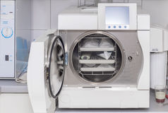 Dental autoclave with dentist's tools Stock Photo