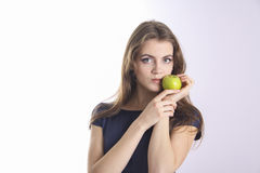 Dental.  beauty holding green apple Royalty Free Stock Images