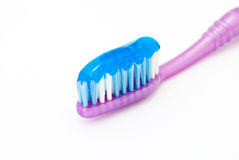 Dental brush. With toothpaste on the white background stock photos