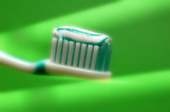 Dental care. Tooth brush with dentifrice in special spot light royalty free stock photos