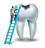 Dental Care. Health and medical symbol with a dentist or doctor in uniform on a ladder to diagnose  symptoms and perform an emergency  surgery on a tooth with a Royalty Free Stock Photos