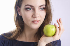 Dental care.  beauty holding green apple Stock Photos