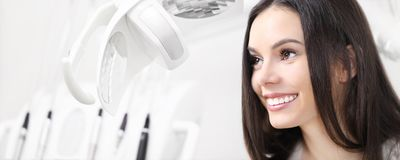 Dental care concept, beautiful smiling woman on dentist clinic b Stock Images