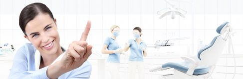 Dental care concept, beautiful smiling woman on dentist clinic b. Dental care concept, beautiful smiling women on dentist clinic background with dentist`s chair royalty free stock photography