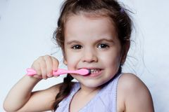 Dental care - little girl cleaning teeth by toothbrush. Dental care - little girl cleaning teeth by toothbrush royalty free stock photos