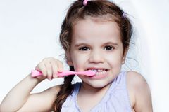 Dental care - little girl cleaning teeth by toothbrush. Dental care - little girl cleaning teeth by toothbrush royalty free stock photography