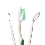 Dental care. Toothbrush and Dental mirror - explorer isolated on white Stock Image