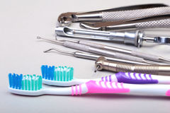 Dental care toothbrush with dentist tools isolated on white background. Selective focus. Royalty Free Stock Images