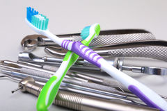 Dental care toothbrush with dentist tools isolated on white background. Selective focus. Royalty Free Stock Photos