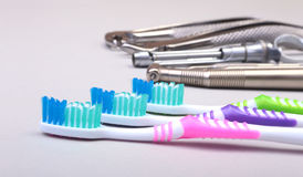 Dental care toothbrush with dentist tools isolated on white background. Selective focus. Stock Images