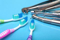 Dental care toothbrush with dentist tools on mirror background. Selective focus. Stock Photo