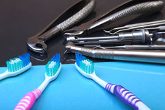 Dental care toothbrush with dentist tools on mirror background. Selective focus. Stock Images