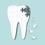 Dental caries. Caries destroys tooth on puzzles Royalty Free Stock Photo