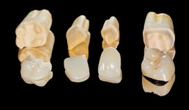 Dental ceramic crowns. On isolated black background royalty free stock images