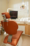 Dental chair. Dentist's workplace in the cabinet Stock Photography