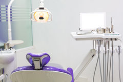 Dental chair with dental equipment Royalty Free Stock Image