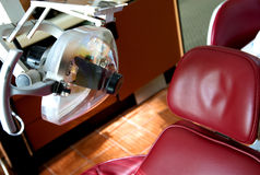 Dental chair dentist insurance. A red dental reclining chair at a dentists office stock photos