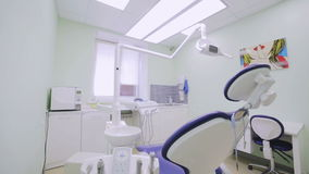 Dental chair in the dentist`s office. The dentist`s workplace. Move the camera on the slider stock video footage