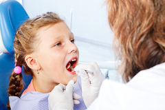 Dental check up. Little patient opens mouth for dental check up Stock Photography