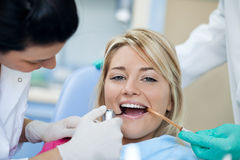 Dental Check-Up. Positive patient at the dentist - dental check-up Royalty Free Stock Photos