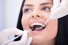 Dental checkup. Beautiful girl having mouth checkup stock images