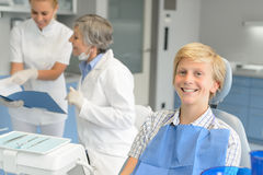 Dental checkup teenage patient and dentist nurse Royalty Free Stock Image