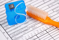 Dental claim form with toothbrush royalty free stock photo