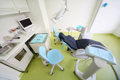 Dental clinic. Chair for patient, table with tools Stock Photos