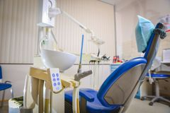 Dental clinic: room with dental chair and medical equipment.  stock image