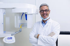 Dental dentist standing with arms crossed Stock Photos